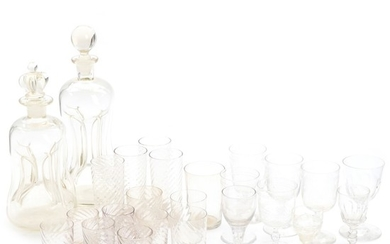 A selection of wine and drinking glasses including two decanters. 19th-20th century. Glasses H. 8.5–12 cm. (25)