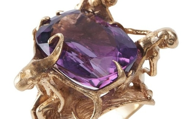AN AMETHYST DRESS RING-Of abstract figural design, featuring an oval amethyst weighing an estimated 19.0cts, in 14ct gold, ring size...