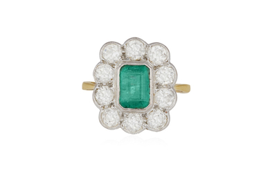 AN EMERALD AND DIAMOND CLUSTER RING, the cut-cornered...