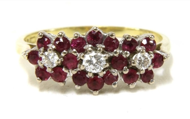 An 18ct gold diamond and ruby triple cluster ring
