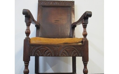 An 18th century oak Wainscote chair with a turned, carved cr...