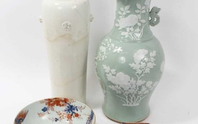 Antique Chinese ceramics, including a large 17th/18th century Dehua blanc de chine cylindrical vase with moulded masks and roundels, 40.5cm height, a 19th century celadon ground vase, an 18th centu...