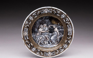 "Attributed to François GUIBERT (active at the end of the 16th-early 17th century). Plate of ""Lot and his daughters"" in enamel painted in grisaille, pink complexions, gold ornaments on a black background. The bottom representing the drunkenness of Lot..."
