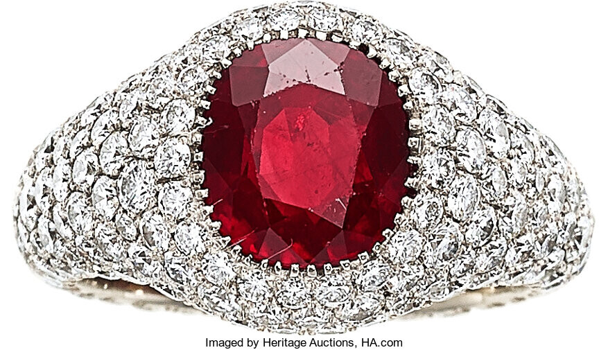 Burma Ruby, Diamond, White Gold Ring The ring features...