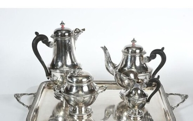 COFFEE SERVICE in solid silver on its tray. Shell model. Gadrooned rim. The 4 solid silver pieces make a total of 2kgs150 and the tray is in silver plated metal.