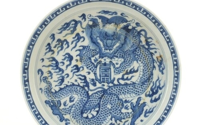Chinese blue and white porcelain dish hand painted with a dr...