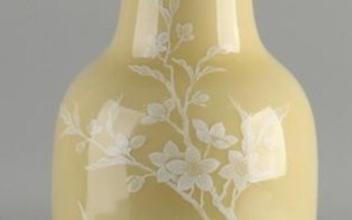 Chinese porcelain vase with ocher-yellow glaze, white