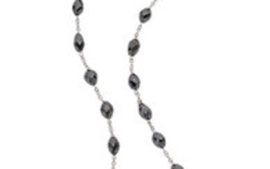 Colored Diamond, White Gold Necklace The necklace features faceted...