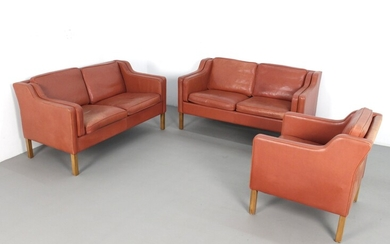 Danish furniture designer, a pair of sofas and chairs, 1960s/1970s in leather (3)