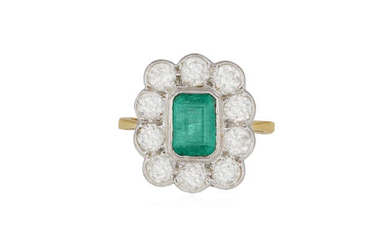Description AN EMERALD AND DIAMOND CLUSTER RING, the cut-cornered...