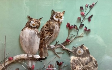 Diorama in feather representing three owls on a...