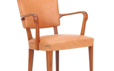 Ernst Kühn, attributed: Armchair of mahogany. Seat and back upholstered with brown coloured leather.