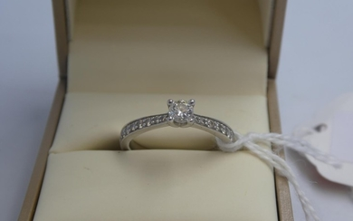 Platinum & diamond ring with central 4 claw set solitaire di...