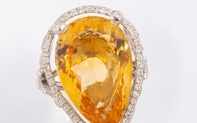 """Ring in 18k (750 thousandths) white gold set with a beautiful pear cut citrine of about 13 ct. of a bright and intense yellow and a very beautiful limpidity. Surrounding and shoulders in """"V"""" shape paved with small diamonds."""