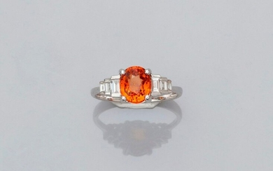 Ring in white gold, 750 MM, set with an oval orange garnet weighing about 2 carats, stepped with rows of baguette-cut diamonds, size: 52, weight: 3.05gr. rough.