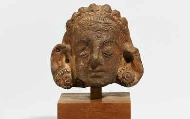 Terracotta head with hair jewels and ear flower