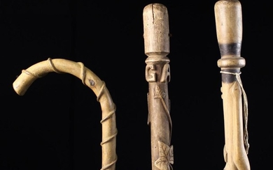 Three Rustic Folk-Art Walking Sticks from the Auvergne Region. The longest with a knobbly shaft entw