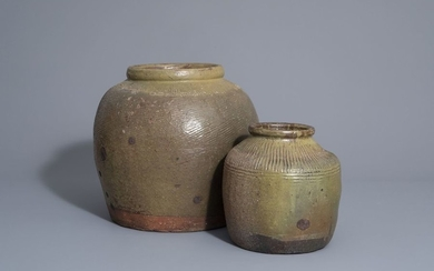 Two green brown storage jars, South East Asia,...