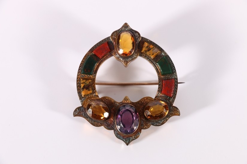 Victorian gilded metal plaid brooch set with Scottish pebble...