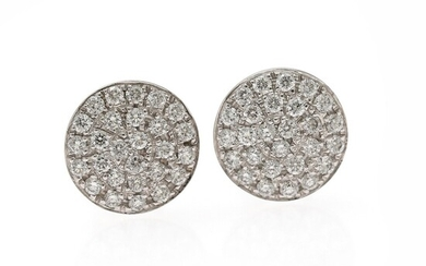 Wallin Jewels: A pair of diamond ear studs each set with numerous diamonds weighing a total of app. 0.65 ct., mounted in 18k white gold. D-F/VVS-VS.