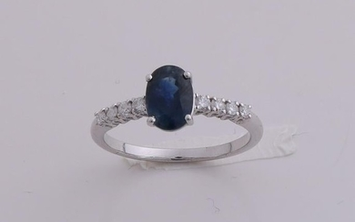 White gold ring, 585/000, with diamond and sapphire.
