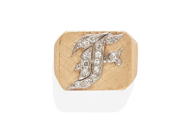 a gold and diamond monogram ring