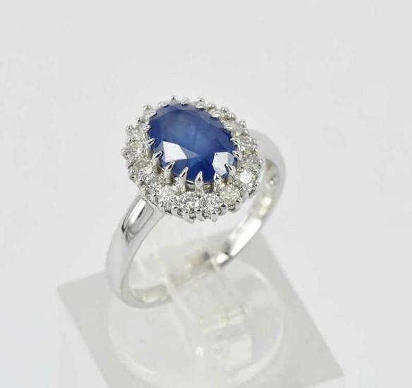 A BLUE SAPPHIRE AND DIAMOND DRESS RING