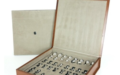 A CASED LEATHER BOUND AND METALLIC CHESS SET The chrome fini...