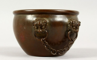 A CHINESE CIRCULAR BRONZE CENSER, with four mask