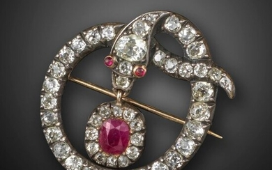 A George III diamond snake brooch pendant, the knotted serpent set with graduated old cushion-shaped diamonds and cabochon ruby eyes, suspending a ruby and diamond cluster drop in silver and gold closed-back mount, folding pendant loop, 3.8cm high, case