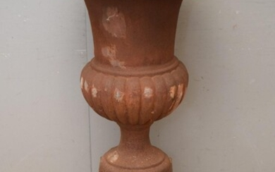 A LARGE CLASSICAL STYLE CAST IRON URN ON BASE (113H X 58W CM) (PLEASE NOTE THIS HEAVY ITEM MUST BE REMOVED BY CARRIERS AT THE CUSTOM...