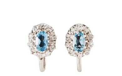 A PAIR OF DIAMOND AND AQUAMARINE CLUSTER EARRINGS, mounted i...