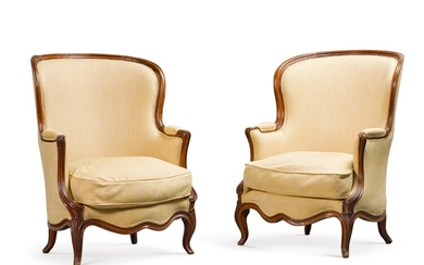 A PAIR OF LOUIS XV CARVED WALNUT BERGÈRES, MID-18TH CENTURY