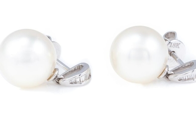A PAIR OF SOUTH SEA PEARL AND DIAMOND STUD EARRINGS; each a 10.5mm round cultured pearl of fine colour and lustre to bale set with 7...