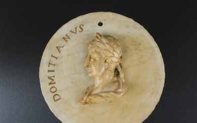 A Roman white marble and giallo di Siena medallion
