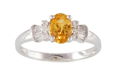A SAPPHIRE AND DIAMOND RING, with central oval cut yellow sa...