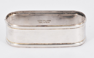 A STERLING SILVER NAPKIN RING