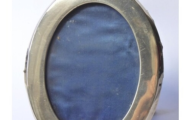 A VICTORIAN SILVER OVAL PHOTOGRAPH FRAME Plain form with eas...