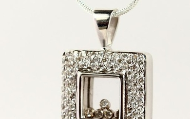 "A WHITE GOLD ""CHOPARD"" STYLE DANCING DIAMOND PENDANT"