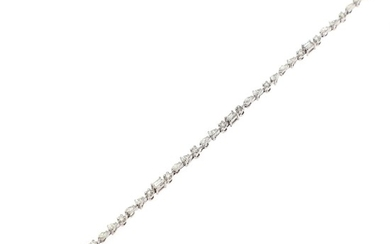 A diamond bracelet set with numerous brilliant, navette and baguette-cut and pear- shaped diamonds totalling app. 2.85 ct., mounted in 14k white gold.