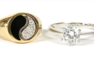 A gold diamond and enamel yin and yang ring