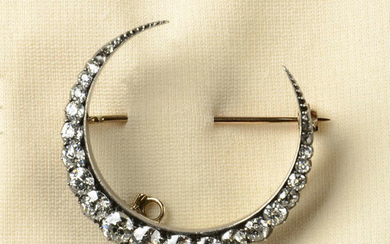 A late Victorian silver and gold old-cut diamond crescent brooch.