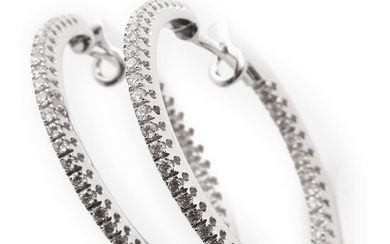 """A pair of diamond ear pendants """"Creoles"""" each set with numerous brilliant-cut diamonds weighing a total of app. 0.80 ct., mounted in 18k white gold. G-H/SI-P1"""
