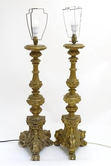 A pair of rococo style table lamps, constructed of