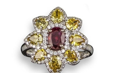 A ruby and fancy diamond cluster ring, of...