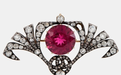 A silver and 14K gold brooch set with a faceted pink tourmaline and old- and rose-cut diamonds