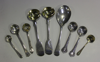 A small group of silver flatware, comprising a pair of Victorian fiddle pattern salt spoons, London