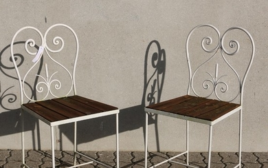 A small suite of iron and wooden garden furniture. Painted. Ca. 1960. (3).