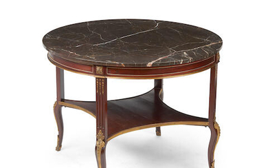 A transitional Louis XV/XVI style marble top gilt bronze mounted mahogany center table