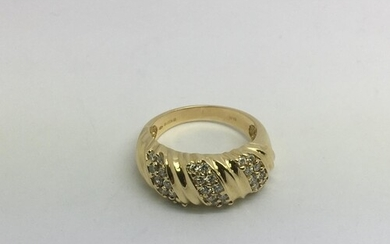 An 18ct gold ring set with thirty small diamonds, approx 7.5...